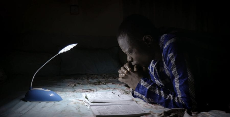 Martins the electrician prays in his home before heading to work
