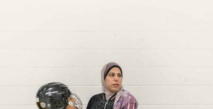 HockeyMom4-Fatma puts on helmet
